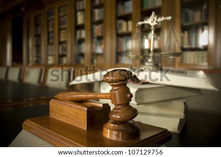 Symbol of law and justice in the library, law and justice concept, focus on the gavel