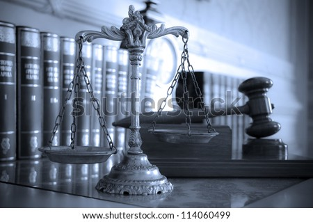 Symbol of law and justice on the table, law and justice concept, focus on the scales, blue tone