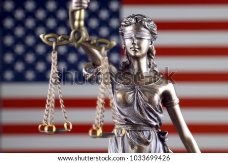 Symbol of law and justice with United States Flag. Close up.