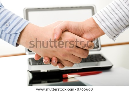 Symbol of partnership: business people shaking hands
