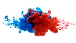 Symbol of rivalry and struggle or merging of a compound. Ink in water red and blue isolated on white