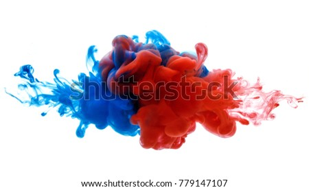 Symbol of rivalry and struggle or merging of a compound. Ink in water red and blue isolated on white #779147107