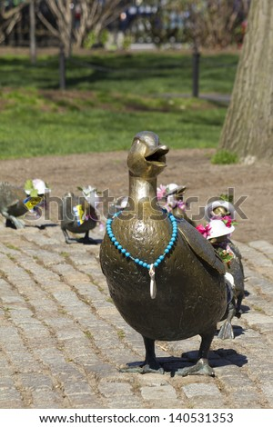 Symbol of the Boston Public Garden and of the city of Boston, the mommy duck and her chicks are dressed for every season in Massachusetts.