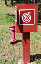 symbol of the fire hose and the red hydrant that can be used by firefighters to extinguish fires