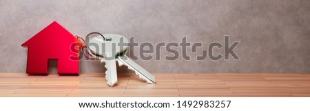 Symbol of the house with silver key. 3d render Foto stock ©