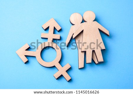 Symbol of transgender and silhouettes of man and woman of wood on blue background