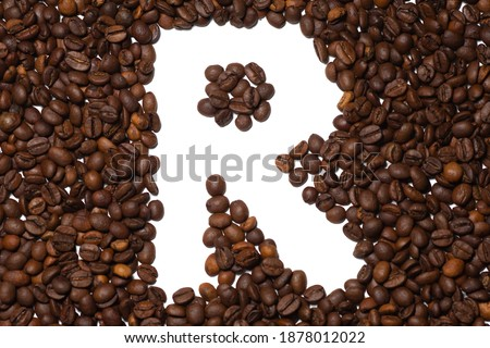 Symbol R, the letter of an aphovite made of coffee. Coffee background, letter R Stock fotó ©