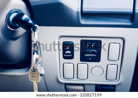 Symbol security door lock buttons and the power button Auto Glass.