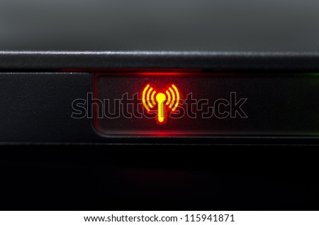 Symbol wireless network signal lights while working on laptop.