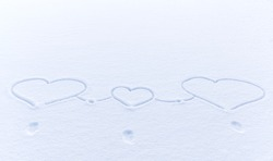symbolic drawing of three hearts in the snow, two large and one small. The concept of Valentine's day, friendly family. ymbol of love, unity, birth of a new life for a couple in love. place for text