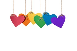 symbolic hearts made of paper in the color of the LGBT community are suspended from ropes.