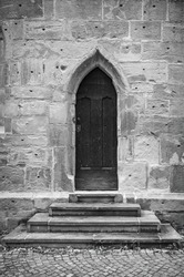 Symbolic image: Gothic pointed arch door in a sacred building using the example of Regiswindis Chapel, Lauffen am Neckar, Baden-Württemberg, Germany.
