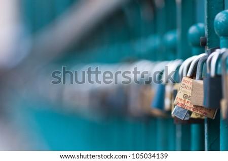 Symbolic love padlocks fixed to the railings of grunwaldzki  bridge, Wroclaw, Poland.