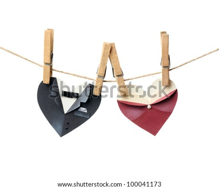 Symbolic male and female heart shapes hanging on the clothesline. Isolated on white. Wedding or st.Valentine theme. - stock photo