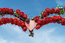 symbolic padlock in the shape of a heart on a clear sky. eternal love and symbolic concepts or ideas of romance
