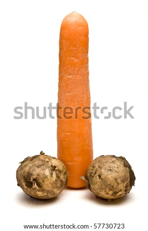 Symbolic phallic concept image of carrot and two potatos isolated against white background.