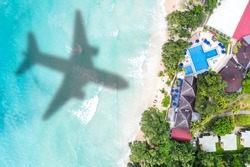 Symbolic picture vacation travel traveling luxury villa sea airplane flying Seychelles aerial photo beach waves