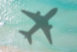Symbolic picture vacation travel traveling sea airplane flying Seychelles aerial photo waves