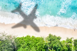Symbolic picture vacation travel traveling sea airplane flying Seychelles beach waves