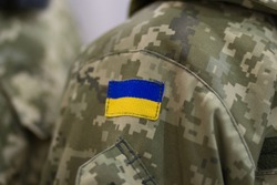 Symbolism of a Ukrainian flag on the uniform. Army