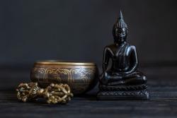 Symbols of Buddhism. Antique Buddha Shakyamuni, sound bowl and vajra.