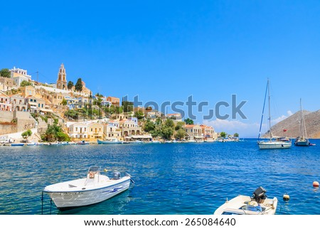 SYMI, GREECE - AUGUST 02, 2014: Fishing boats moored in Yialos harbour on August 02, 2014 on Symi island, Greece. Yialos, the main harbour on Symi, is a popular destination for day trips from Rhodes.