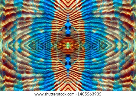 Symmetric pattern formed by the pattern on the surface of the texture of the old wall of natural wood. Vintage wooden wall with peeling blue paint. Image with a mirror effect. Amazing seamless pattern