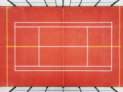 symmetrical aerial view of a paddle tennis court