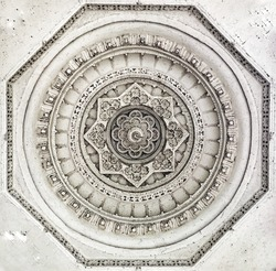 Symmetrical carving on a temple ceiling