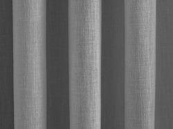 Symmetrical folds in a curtain, focus on ridges.