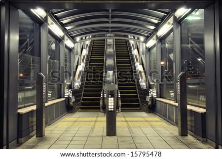 symmetrical interior with modern escalators at night time, Tokyo Japan