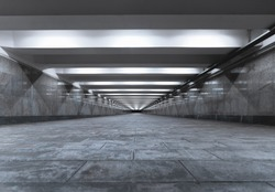 Symmetrical pedestrian underpass and outgoing perspective. Gray concrete and tile transition.