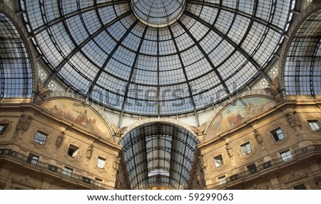 Symmetrical shot of the famous luxury shopping mall Galleria Vittorio Emanuele II in Milan, Italy, showing the spectacular ceiling of this gate to luxury