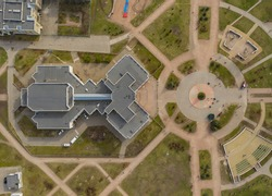 symmetrical soviet architecture from above. view of the buildings and symmetrical square. summer day with an urban area of the city of Kiev. hospital in eastern europe. 4k Aerial