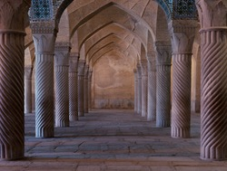 Symmetrical spiral columns in a hall of  Vakil mosque in Shiraz, Iran.