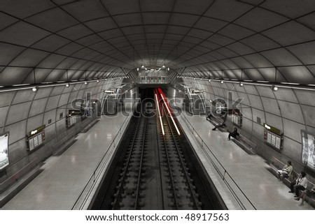 Symmetrical view of train approaching, blurred by motion blur, leaving traces of red light in underground of Bilbao, Spain