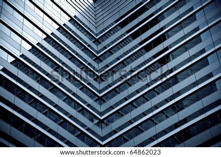 Symmetry in a modern glass-fronted office tower