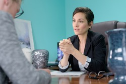 sympathetic undertaker in meeting with client in her office