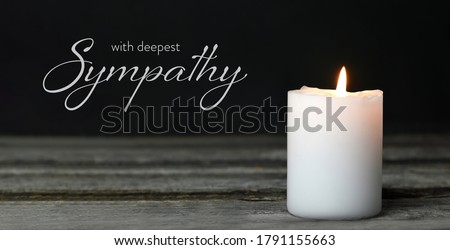 Sympathy card. Memorial candle on wooden background Foto stock ©
