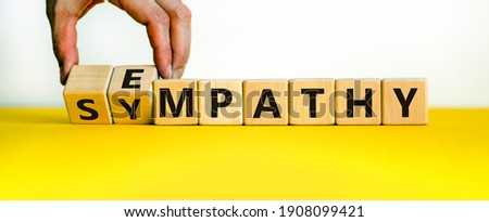 Sympathy or empathy symbol. Businessman turns wooden cubes and changes the word 'empathy' to 'sympathy'. Beautiful white background. Copy space. Psychological, sympathy or empathy concept. Photo stock ©