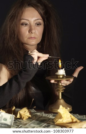 Sympothetic girl as a witch on a dark background