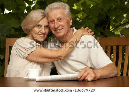 df64a4f7 Sympothetic older couple sitting at a table at home on the veranda  #136679729