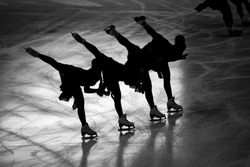 Synchronized skaters doing spirals black and white