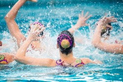 Synchronized swimming competition in a large pool