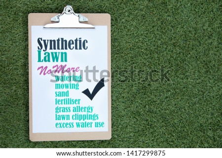 Synthetic lawn benefits sign on synthetic lawn #1417299875