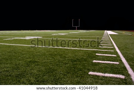 Synthetic turf football field at night