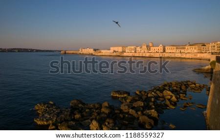 Syracuse, Italy - June 30 2017: The  historic port Syracuse, Sicily under sunrise.  #1188559327