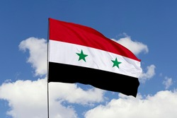 Syria flag isolated on the blue sky with clipping path. close up waving flag of Syria. flag symbols of Syria.