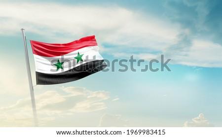 Syria national flag waving in beautiful sky. Stockfoto ©