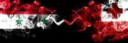Syria vs Tonga, Tongan smoke flags placed side by side. Thick colored silky smoke flags of Syrian and Tonga, Tongan